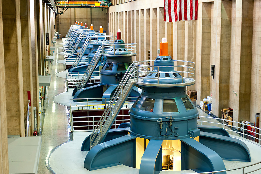 View inside of the historic Hoover Dam plant. Hoover Dam, is a popular tourist destination and was once known as Boulder Dam, is a concrete arch-gravity dam in the Black Canyon of the Colorado River, on the border between the US states of Arizona and Nevada. It was constructed between 1931 and 1936, and was dedicated on September 30, 1935 by President Franklin Roosevelt.