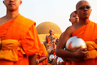 Buddhist monks prepare for alms offering ceremony at the Wat Phra Dhammakaya temple in Pathum Thani province, north of Bangkok on Makha Bucha Day March 4, 2015. The Dhammakaya temple members include some of Thailand's most powerful politicians and is regarded as the country's richest Buddhist temple. Makha Bucha Day honours Buddha and his teachings, and falls on the full moon day of the third lunar month.  REUTERS/Damir Sagolj (THAILAND)