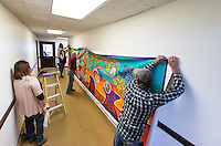 The finished Educational Empowerment Mural is installed in the old wing of the Academic Commons on May 6, 2014. The mural was created by Bianca Fonseca Cervantes '14, Jacqueline Ayala '14 and Highland Park artist Pola Lopez. (Photo by Marc Campos, Occidental College Photographer)
