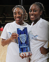 STANFORD, CA - February 23, 2012:  The Ogwumike sisters hold the Pac-12 Championship trophy after Stanford's 68-46 victory over Colorado in Stanford, California on February 23,  2012.