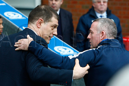 21.02.2016. Ewood Park, Blackburn, England. Emirates FA Cup 5th Round. Blackburn Rovers versus West Ham United. Blackburn Rovers manager Paul Lambert (right) greets West Ham United manager Slaven Bilic before the game.
