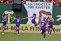 Portland, Oregon - Sunday April 17, 2016: Orlando Pride defender Stephanie Catley (7) celebrates scoring with teammates. The Portland Thorns play the Orlando Pride during a regular season NWSL match at Providence Park.