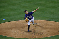 Jorge De La Rosa #29 of the Colorado Rockies pitches against the Los Angeles Dodgers at Dodger Stadium on April 30, 2013 in Los Angeles, California. (Larry Goren/Four Seam Images)
