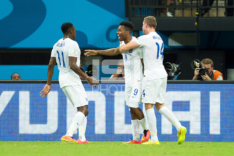 Daniel Sturridge of England celebrates scoring a goal with Jordan Henderson and Danny Welbeck after making it 1-1