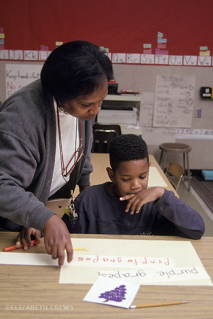 Oakland CA Teacher helping learning handicaped student try to learn letters  and words by connecting concepts and words  MR