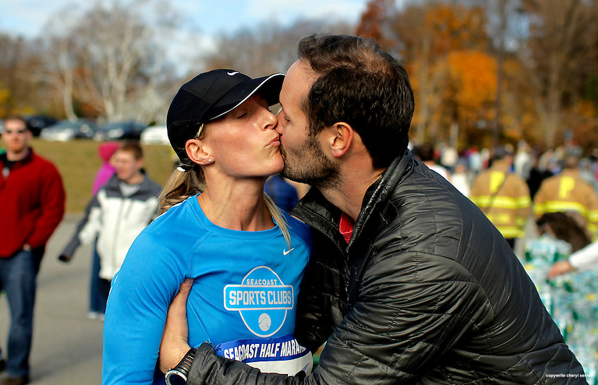Megan Parker of Portsmouth gets a kiss from husband Jon after coming in first in the women's division of the Seacoast Half-Marathon road race in Portsmouth, N.H. Sunday, Nov. 14,  2010.  (Portsmouth Herald Photo Cheryl Senter)