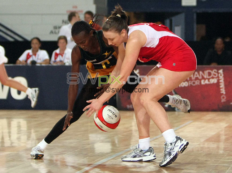 PICTURE BY Ben Duffy/SWPIX.COM - Netball - The Co-Operative International Series - England v Jamaica, Second Test - The Skydome arena, Coventry, England - 24/02/09...Copyright - Simon Wilkinson - 07811267706...England's JAde Clarke and  Jamaica's Paula Thompson