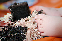 Baby feet in a birthday cake