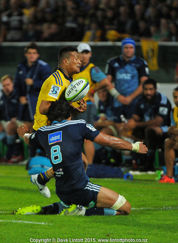 Steven Luatua tries to tackle Ardie Savea during the Super Rugby match between the Hurricanes and Blues at FMG Stadium, Palmerston North, New Zealand on Friday, 13 March 2015. Photo: Dave Lintott / lintottphoto.co.nz