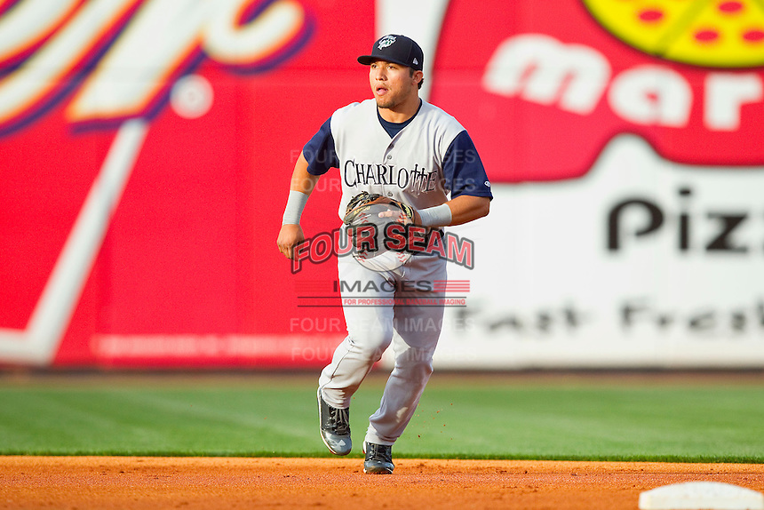 Charlotte Knights shortstop Carlos Sanchez (13) on defense against the Toledo Mudhens at 5/3 Field on May 3, 2013 in Toledo, Ohio.  The Knights defeated the Mudhens 10-2.  (Brian Westerholt/Four Seam Images)