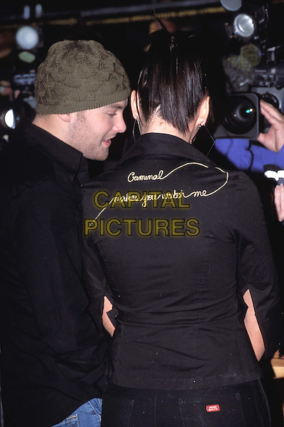 KEVIN SIMM & MICHELLE HEATON - LIBERTY X.The League Of Extraordinary Gentlemen premiere, Leicester Square.writing, slogan shirt, back, miss sixty jeans.www.capitalpictures.com.sales@capitalpictures.com.© Capital Pictures.