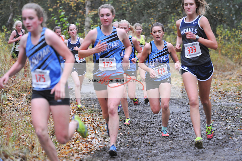 From left, Chugiak's KayLee Manwaring, Hannah Booher, Brynn Kruchoski and Eagle River's Peyton Young lead  the way round a muddy turn in the  Region IV Cross Country Championships @ Bartlett High School Saturday, Sept 26, 2015.