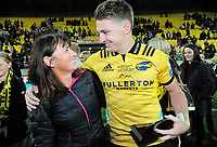 Hurricanes centurion Beauden Barrett with his mum Robyn after the Super Rugby match between the Hurricanes and Crusaders at Westpac Stadium in Wellington, New Zealand on Saturday, 10 March 2018. Photo: Dave Lintott / lintottphoto.co.nz