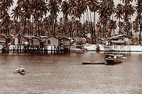 Stilt houses on the small island of Mabul near Sipidan Island, just off the coast of Borneo.  Sabah, Malaysia.