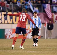 Jermaine Jones, Nicolas Burdisso. The USMNT tied Argentina, 1-1, at the New Meadowlands Stadium in East Rutherford, NJ.
