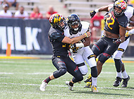 College Park, MD - September 9, 2017: Towson Tigers wide receiver Rodney Dorsey (26) gets tackled during game between Towson and Maryland at  Capital One Field at Maryland Stadium in College Park, MD.  (Photo by Elliott Brown/Media Images International)