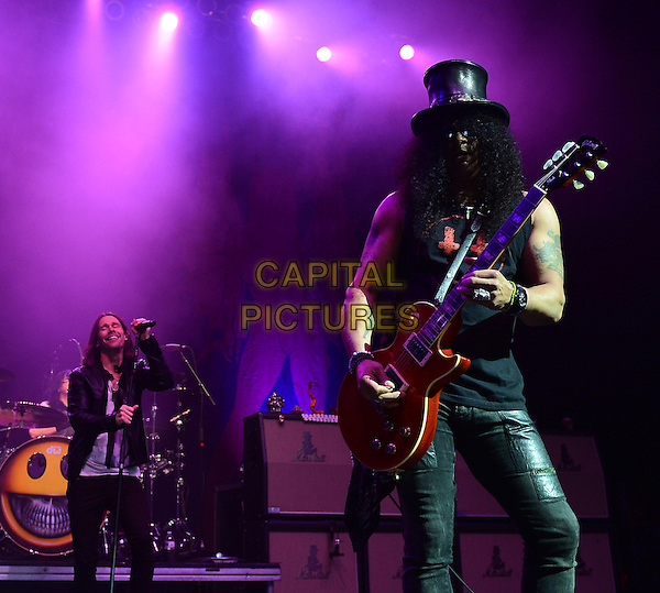 HOLLYWOOD, FL - AUGUST 29: Slash (R) performs with Myles Kennedy and The Conspirators at Hard Rock Live! in the Seminole Hard Rock Hotel &amp; Casino on August 29, 2014 in Hollywood, Florida.  <br /> CAP/MPI/mpi10<br /> &copy;mpi10/MediaPunch/Capital Pictures