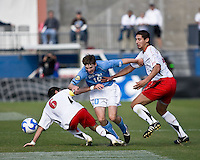 North Carolina forward Billy Schuler (10) attempts to move between Maryland midfielder Rich Costanzo (5) and Maryland defender Omar Gonzalez (4).  Maryland Terrapins defeated North Carolina Tar Heels 1-0 to win the NCAA Men's College Cup at Pizza Hut Park in Frisco, TX on December 14, 2008.  Photo by Wendy Larsen/isiphotos.com