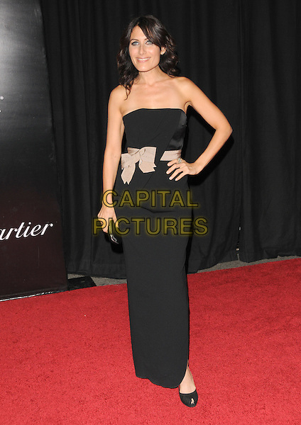LISA EDELSTEIN.The 2009 Rodeo Walk of Style Awards held at Rodeo Dr. in Beverly Hills, California, USA..October 22nd, 2009.full length black strapless dress beige bow sash waist hand on hip .CAP/RKE/DVS.©DVS/RockinExposures/Capital Pictures.