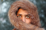 A young boy with a green eyes looking sharply. Photo by Sanad Ltefa