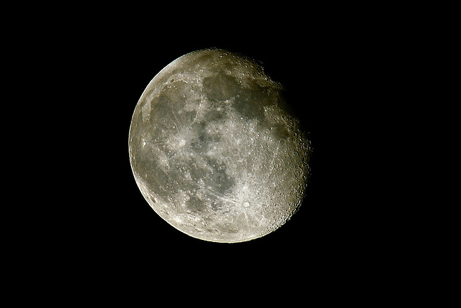 Close up view of a full moon and it's craters in the night sky