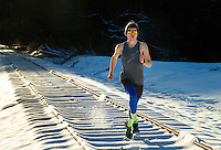 Snow Photography - Photography of a distance runner running along the snow covered railroad tracks in Davidson North Carolina. <br /> <br /> Charlotte Photographer - PatrickSchneiderPhoto.com