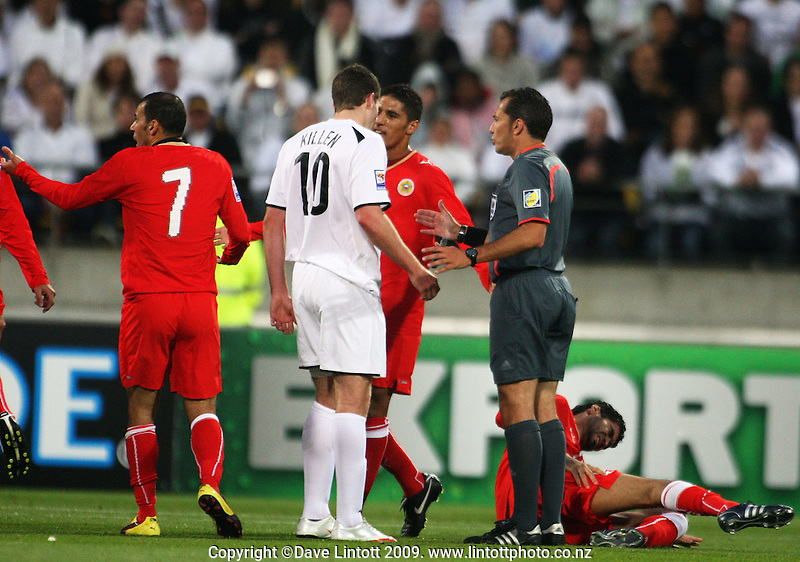 Chris Killen and Bahrain's Faouzi Mubarak Aaish have words as referee Jorge Larrionda steps in after a foul by Killen during the second leg of the FIFA World Cup soccer qualifying play-off between New Zealand All Whites and Bahrain at Westpac Stadium, Wellington, New Zealand on Saturday, 14 November 2009. Photo: Dave Lintott / lintottphoto.co.nz