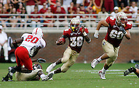 TALLAHASSEE, FL 10/31/09-FSU-NCST FB09 CH60-Florida State running back Jermaine Thomas keeps an eye on N.C. State's C.J. Wilson as FSU center Ryan McMahon (60) leads the way during first half action Saturday at Doak Campbell Stadium in Tallahassee. .COLIN HACKLEY PHOTO