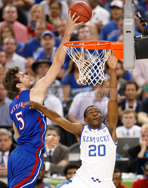 Kansas forward Jeff Withey blocks a shot by sophomore guard Doron Lamb during the first half of the Kentucky vs. Kansas National Championship game at the Super Dome in New Orleans, Louisiana  April 2, 2012. Photo by Brandon Goodwin | Staff