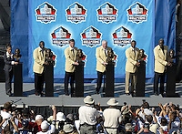 Sara White, wife of hall of fame inductee Reggie White, left to right, Harry Carson, Troy Aikman, John Madden, Warren Moon, and Rayfield Wright pose with their busts following the Pro Football Hall of Fame induction ceremony Saturday, Aug. 5, 2006, in Canton, Ohio.<br />