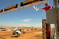 Apr 17, 2011; Surprise, AZ USA; LOORRS driver John Fitzgerald (314) takes the checkered flag to win round 4 at Speedworld Off Road Park. Mandatory Credit: Mark J. Rebilas-