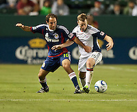 CARSON, CA – APRIL 30, 2011: Chivas USA midfielder Nick LaBrocca (10) battles for the ball with New England Revolution forward Zack Schilawski (15) during the match between Chivas USA and New England Revolution at the Home Depot Center, April 30, 2011 in Carson, California. Final score Chivas USA 3, New England Revolution 0.