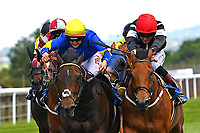 Red Alert yellow ridden by Joesephine Gordon and Secret Agent ridden by George Wood battle out the finish of Winner of The Sharp's Doom Bar Handicap,during Afternoon Racing at Salisbury Racecourse on 13th June 2017