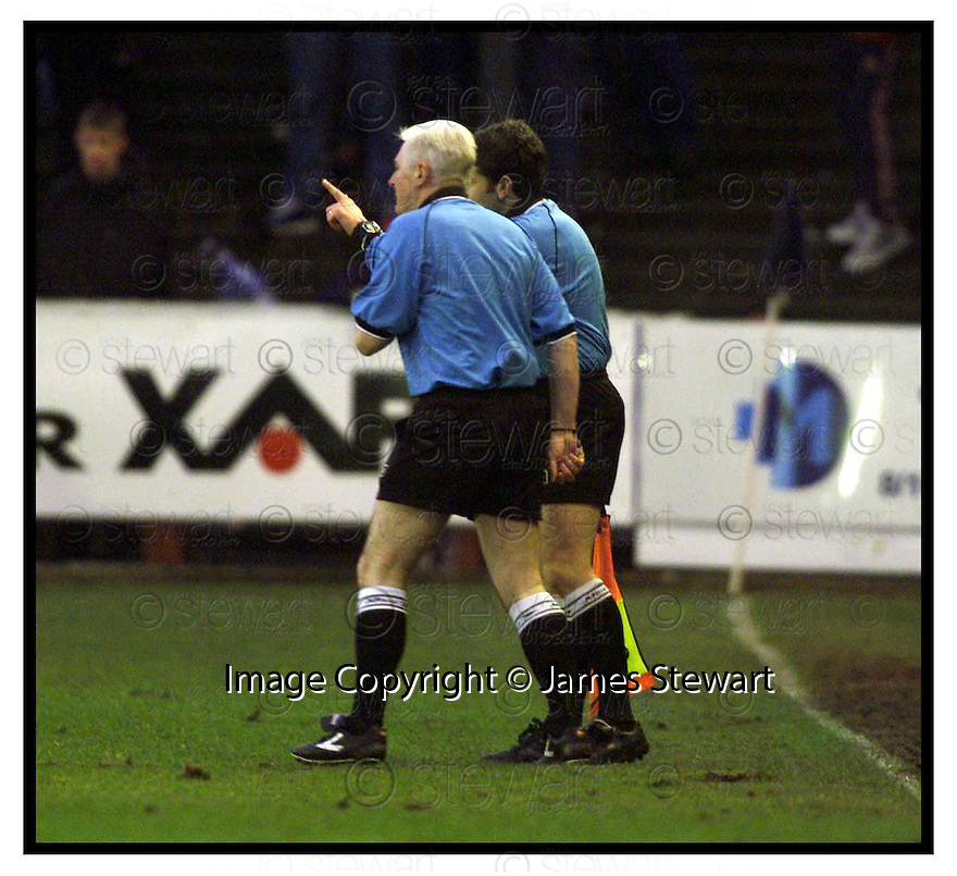 27th December 1999                 Copyright Pic : James Stewart .Ref :                           .File Name : stewart06-falkirk v livingston                       .REFEREE MARTIN CLARK HAS A WORD WITH LINESMAN A THURSTON BEFORE SENDING OFF DAVID SINCLAIR......Payments to :-.James Stewart Photo Agency, Stewart House, Stewart Road, Falkirk. FK2 7AS      Vat Reg No. 607 6932 25.Office : +44 (0) 1324 630007        Mobile : 07721 416997.Fax     : +44 (0) 1324 630007.E-mail : jim@jspa.co.uk.If you require further information then contact Jim Stewart on any of the numbers above.........