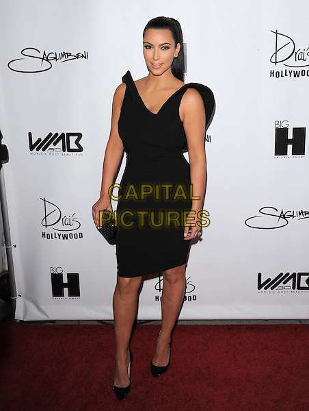 Kim Kardashian.he World's Most Beautiful Magazine Launch Event held at Drai's in Hollywood, California, USA..August 10th, 2011                                                                                .full length dress black sleeveless shoes clutch bag.CAP/RKE/DVS.©DVS/RockinExposures/Capital Pictures.
