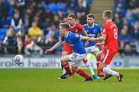Connor Ronan of Portsmouth gets away from Jake Hessenthaler and Lee Martin of Gillingham during Portsmouth vs Gillingham, Sky Bet EFL League 1 Football at Fratton Park on 10th March 2018