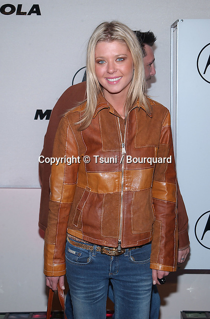 Tara Reid  arriving at the Motorola 3rd annual party, Toys for Tots at the Highland at Highland and Hollywood in Los Angeles. December 6, 2001.          -            ReidTara01A.jpg