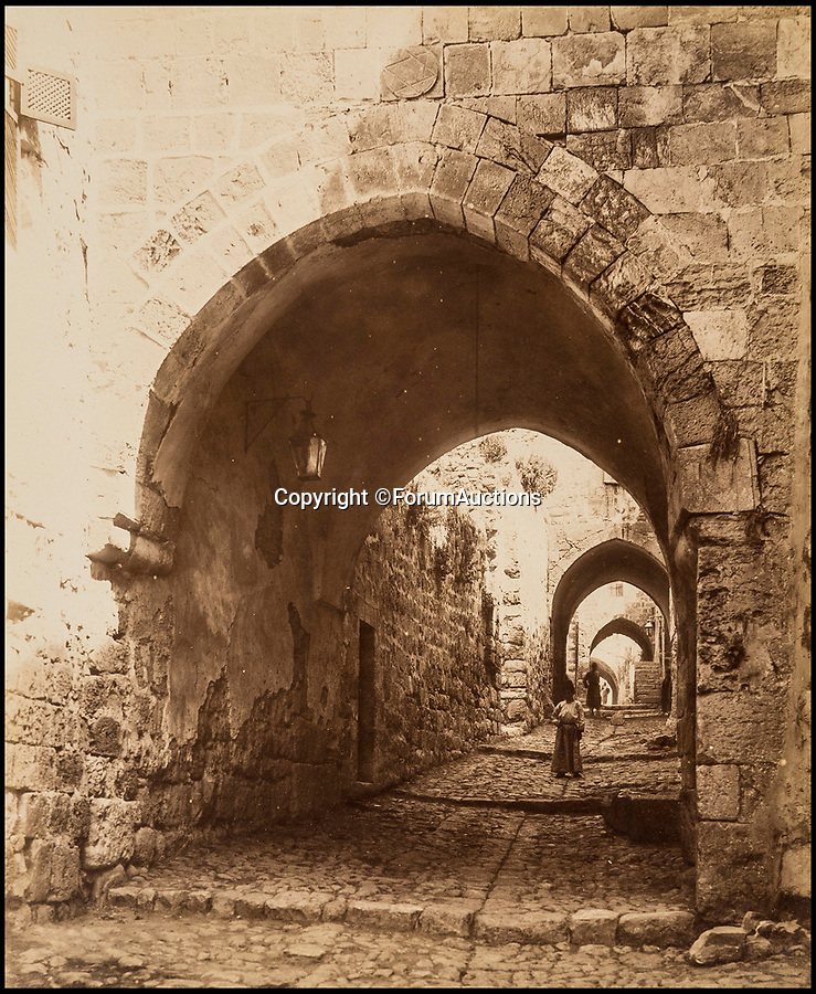 BNPS.co.uk (01202 558833)Pic: ForumAuctions/BNPS<br /> <br /> The Via Dolorosa - a street within the Old City of Jerusalem where Christ walked on the way to his crucifixion.<br /> <br /> Palestine 1870-80's.<br /> <br /> Captivating early photos of Palestine have come to light 140 years later which provide a fascinating glimpse into life in the Holy Land.<br /> <br /> French photographer Levant Bonfils' snaps of Palestine from the 1870s and 1880s include views of Jerusalem, the road to Bethlehem and Jaffa Port.<br /> <br /> It was a pivotal time in the history of Palestine which was experiencing a major influx of Jewish settlers fleeing persecution in Eastern Europe.