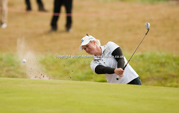 Brittany Lincicome escapes from the greenside bunker at the 6th hole on her way to take the clubhouse lead at 5 under par during the first round play of the  Ricoh Woman's British Open to be played over the Championship Links from 28th to 31st July 2011; Picture Stuart Adams, SAFOTO. www.safoto.co.uk; 28th July 2011