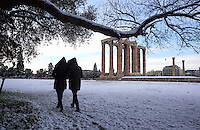 Pictured: People walk past the Olympic Zeus columns in Athens, Greece. Tuesday 10 January 2017<br />