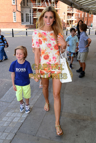 Zachary &amp; Stacey Solomon<br /> The screening of Disney's &quot;the Little Mermaid&quot; held at the Royal Albert Hall, London, England.<br /> August 29th, 2013<br /> full length white dress orange pink floral print top shorts gold bag purse blue t-shirt green shorts mother mom mum son family<br /> CAP/BF<br /> &copy;Bob Fidgeon/Capital Pictures