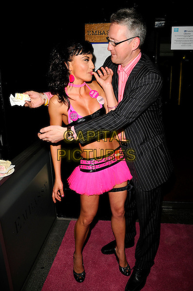 GABRIELLA IRIMIA, LEMBIT OPIK .The Cheeky Girls celebrate 6 years of their career with a party at Embassy club in London, England, June 10th 2008..full length pink black bra top halterneck mini skirt garter sexy badges twins sisters crop tummy midriff cake pinstripe suit glasses eating couple hands  hugging kissing.CAP/CAN.©Can Nguyen/Capital Pictures