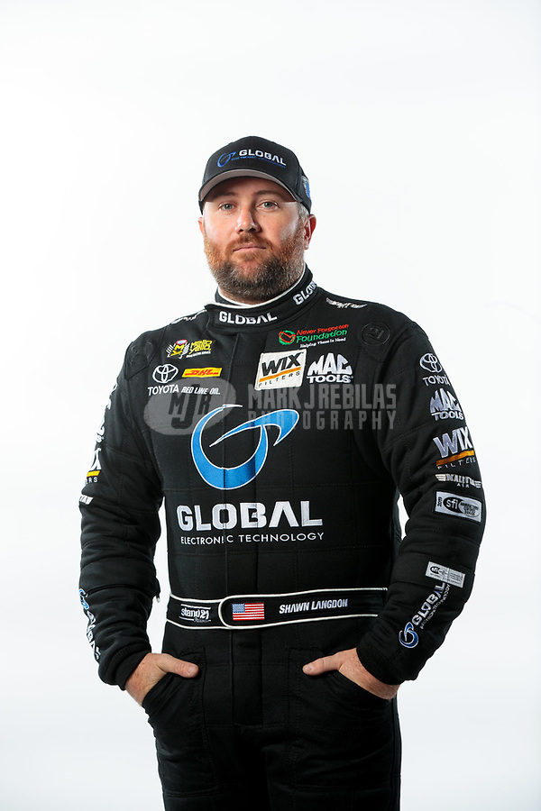 Feb 6, 2019; Pomona, CA, USA; NHRA funny car driver Shawn Langdon poses for a portrait during NHRA Media Day at the NHRA Museum. Mandatory Credit: Mark J. Rebilas-USA TODAY Sports