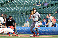 Pitcher / First Baseman Sam Hentges (24) of Mounds View High School in Shoreview, Minnesota takes a throw as Luke Dystra (4) dives back to first during the Under Armour All-American Game on August 24, 2013 at Wrigley Field in Chicago, Illinois.  (Mike Janes/Four Seam Images)