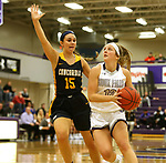 SIOUX FALLS, SD - DECEMBER 7: Kaely Hummel #12 from the University of Sioux Falls eyes the basket against Hanna Vidlund #15 from Concordia St. Paul during their game Friday night at the Stewart Center in Sioux Falls, SD. (Photo by Dave Eggen/Inertia)