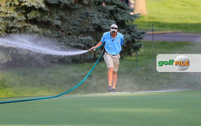 Ground staff water the green at the end of Monday's Practice Day of the 95th PGA Championship 2013 held at Oak Hills Country Club, Rochester, New York.<br /> 5th August 2013.<br /> Picture: Eoin Clarke www.golffile.ie