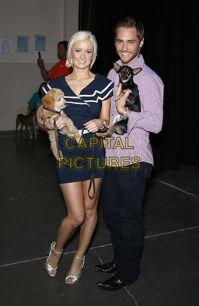 "HOLLY MADISON & JOSH STRICKLAND.The Animal Foundations 8th Annual ""Best In Show"" at The Orleans Arena Las Vegas, Las Vegas, Nevada, USA..May 1st, 2011.full length blue navy dress white trim stripe carrying dog animal pet black trousers shirt purple check nautical .CAP/ADM/MJT.© MJT/AdMedia/Capital Pictures."