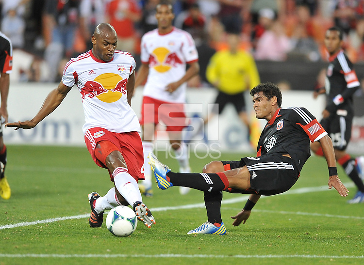 Rafael Teixeira (9) of D.C. United goes against Jamison Olave of The New York Red Bulls (4) The New York Red Bulls defeated D.C. United  2-0, at RFK Stadium, Saturday April 13, 2013.