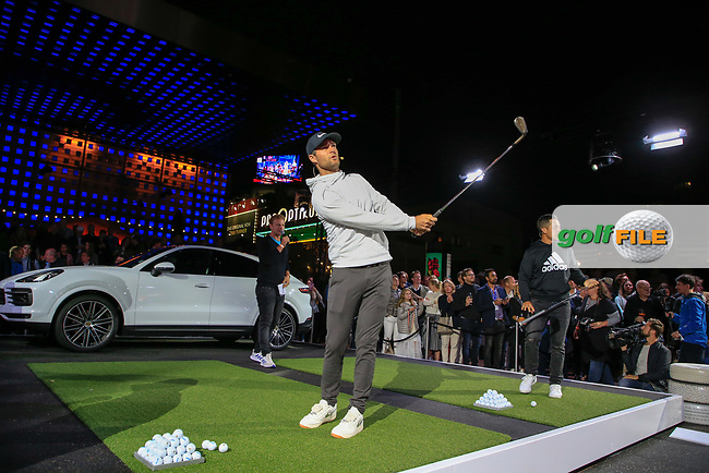 Lucas Bjerregaard (DEN) and Xander Schauffele (USA) at the Porsche Urban Golf Challenge in the Reeperbahn the famous Red light district in Hamburg ahead of the Porsche European Open at Green Eagles Golf Club, Luhdorf, Winsen, Germany. 03/09/2019.<br /> Picture Fran Caffrey / Golffile.ie<br /> <br /> All photo usage must carry mandatory copyright credit (© Golffile   Fran Caffrey)