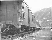 #212 baggage &amp; coach combine with man on back of car at Silverton.<br /> D&amp;RGW  Silverton, CO  1949